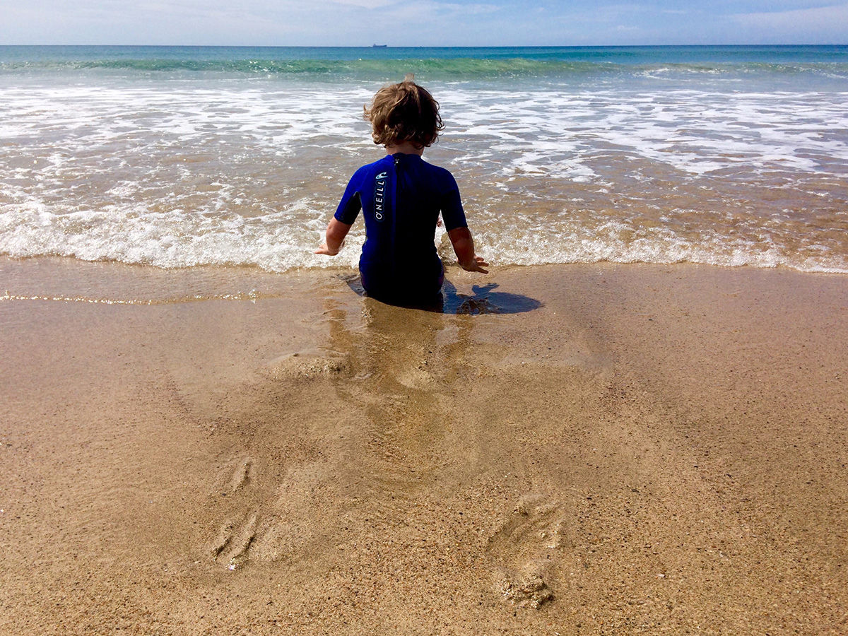 Boy playing on the beach - Cornwall